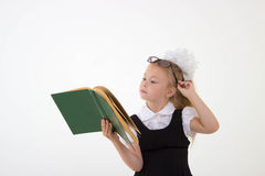 Little girl reading book, preparing for school Royalty Free Stock Photos