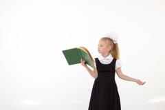 Little girl reading book, preparing for school Stock Image