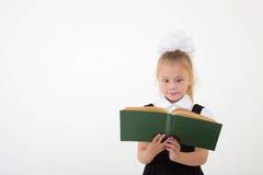 Little girl reading book, preparing for school Royalty Free Stock Photo