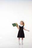 Little girl reading book, preparing for school Royalty Free Stock Images