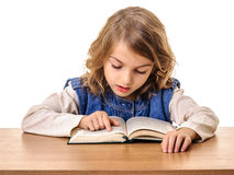 Little girl reading book at school Stock Images