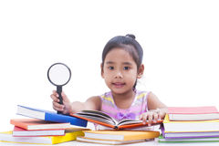 Little girl is reading book Stock Photos