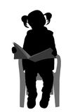 Little girl reading a book silhouette Stock Image