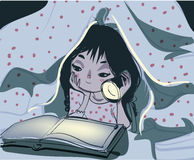 Little girl reading book under a blanket using flash light Royalty Free Stock Images