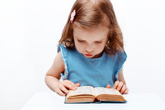 Little girl reading book. on white background royalty free stock images