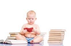 Little girl reading books Stock Photo