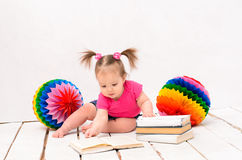 Little girl reading books Royalty Free Stock Photography