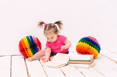 Little girl reading books Royalty Free Stock Photos