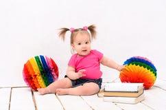 Little girl reading books Stock Photography
