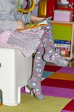 Little girl reading colourful book. With pictures and text Royalty Free Stock Images