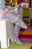 Little girl reading colourful book. With pictures and text Stock Image