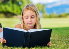 Little Girl Reading Stock Photo