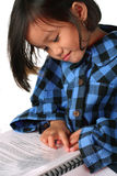 Little girl reading a document Stock Photography