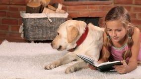 Little girl reading on the floor stock footage