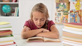 Little girl reading her book aloud stock video