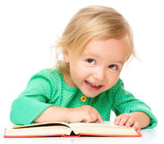 Little girl is reading her book Stock Photos