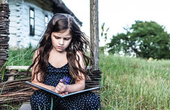 Little girl reading an interesting book Royalty Free Stock Photo