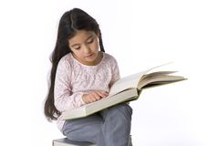 Little Girl Is Reading A Large Book Stock Images