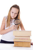Little girl reading with loupe isolated Stock Image
