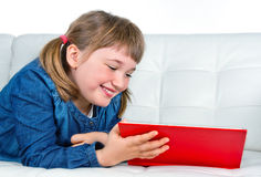 Little girl reading a red book Royalty Free Stock Images