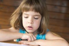 Little girl reading Royalty Free Stock Photos