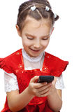 Little girl reading sms on cell Royalty Free Stock Image