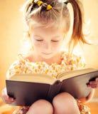 Little Girl Reading The Book Stock Photos