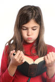 Little girl reads Stock Images