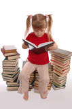 The little girl reads the book. On a white background Royalty Free Stock Photo