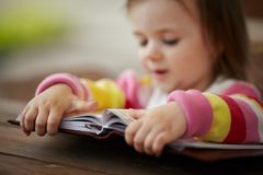Little girl reads book Stock Image