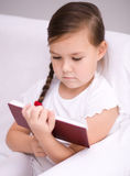 Little girl reads a book Royalty Free Stock Images