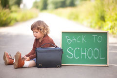 Little girl ready back to school, little genius Royalty Free Stock Photos