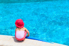 Little girl ready to jump into the pool with noodle Stock Images