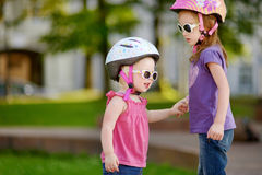 Little girl ready to ride a bicycle Royalty Free Stock Photos