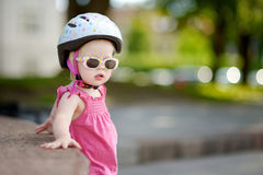 Little girl ready to ride a bicycle Stock Photography