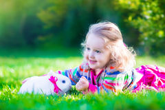 Little girl and real rabbit Royalty Free Stock Image