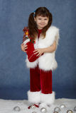 Little girl received Christmas gift Stock Photo