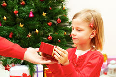 little girl receives a Christmas gift Royalty Free Stock Photos