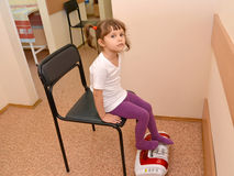 The little girl receives procedure on a roller masseur.  Stock Images