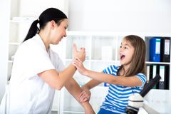 Little girl receiving injection  with a smile Stock Photo