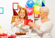 Little girl recieve present from grandmother Royalty Free Stock Photo