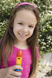 Little Girl With A Recorder Stock Images