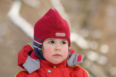 Little girl in red. Portrait of the little girl in red, looking forward Stock Photo