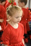 Little girl in red. Pretty little girl in the red dress and flower in hair Stock Image