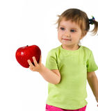 Little girl with red apple Stock Image