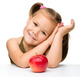Little girl with red apple Stock Photo