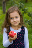 Little Girl And Red Apple stock photography