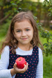 Little Girl And Red Apple stock images
