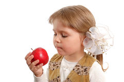 The little girl with a red apple in a hand. On a white background Stock Photo