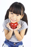 A little girl with red apple Royalty Free Stock Image